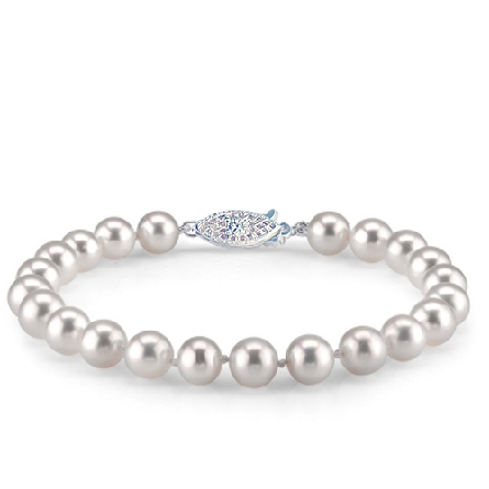 seven inch bracelet of AA quality 4-4.5mm freshwater pearls; 14 karat white gold clasp