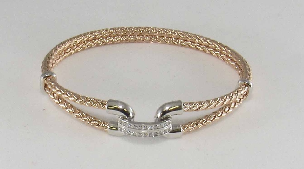 sterling silver bracelet; double strand rose gold plated woven wire with silver hook clasp at front covered with a couble row of cubic zirconia