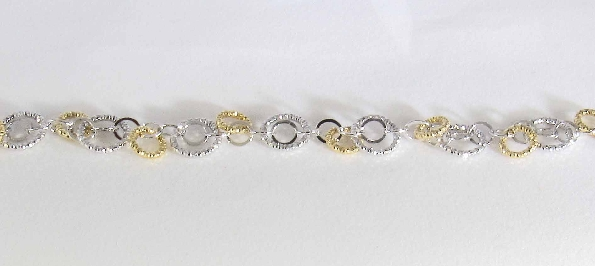 sterling silver and gold plate over sterling silver interlocking diamond cut circle bracelet; 7.25 inches; lobster claw