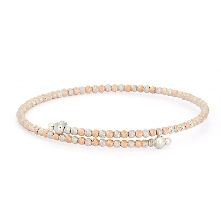 sterling silver and rose gold plate bracelet; diamond cut beads on memory wire