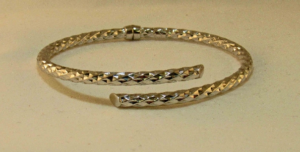 sterling silver hinged bypass bangle bracelet with faceted texture