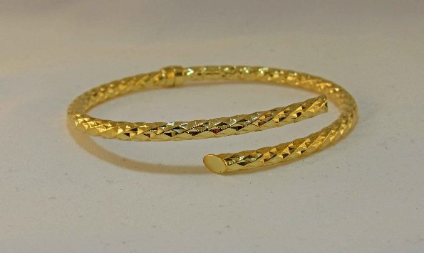 sterling silver with gold plate hinged bypass bangle bracelet with faceted texture