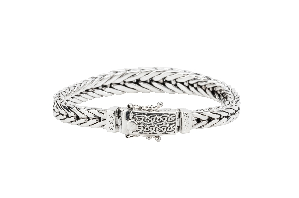 This bracelet is part of Keith Jack s Celtic-inspired Dragon Weave Collection. Made of sterling silver; the 8.5 inch tapered bracelet has a tongue and groove clasp and double safety latches. Wear this bracelet to signify life's continually evolving p