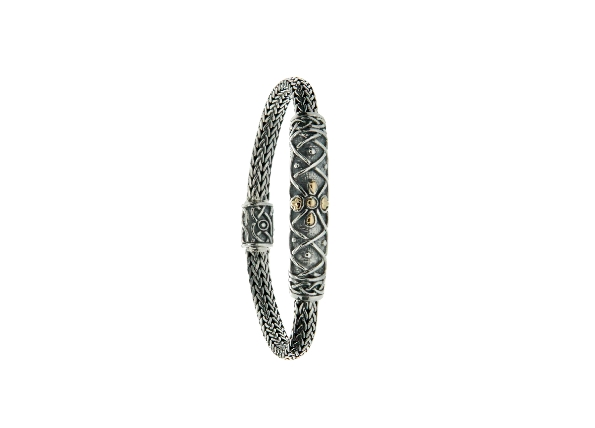 This 7.5 inch bracelet is part of Keith Jack s Celtic-inspired Labyrinth collection. It is made of sterling silver with 18 karat yellow gold. The Celtic labyrinth reflects the intricate paths that we travel throughout our lives. Let intuition be your